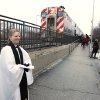 Pastor Emily Mellott, of the Calvary Episcopal Church in Lombard, Ill. , offers Ashes to Go to commuters at the Lombard train station on Wednesday, Feb. 22, 2012. (AP Photo/Daily Herald, Daniel White) MANDATORY CREDIT, MAGS OUT, TV OUT