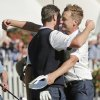 Europe\'s Ian Poulter, right, congratulates Justin Rose after Rose defeated USA\'s Phil Mickelson in a singles match at the Ryder Cup PGA golf tournament Sunday, Sept. 30, 2012, at the Medinah Country Club in Medinah, Ill. (AP Photo/Charlie Riedel) ORG XMIT: PGA168