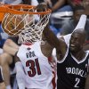 Photo - Brooklyn Nets forward Kevin Garnett, right, dunks against the Toronto Raptors during the second half of Game 2 in an NBA basketball first-round playoff series, Tuesday, April 22, 2014, in Toronto. (AP Photo/The Canadian Press, Nathan Denette)