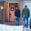CORRECTS TO THREE PEOPLE DEAD NOT FIVE Law enforcement officials enter a home on Tuesday, Dec. 25, 2012 in Flint, Mich. Authorities say three people are dead in Flint from what is believed to be accidental carbon monoxide poisoning. (AP Photo/Flint Journal, Griffin Moores)