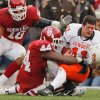 Oklahoma State quarterback Zac Robinson (11) has his helmet knocked off by Oklahoma\'s Jeremey Beal (44) during the first half of the Bedlam college football game between the University of Oklahoma Sooners (OU) and the Oklahoma State University Cowboys (OSU) at the Gaylord Family -- Oklahoma Memorial Stadium on Saturday, Nov. 24, 2007, in Norman, Okla. Photo by Chris Landsberger, The Oklahoman