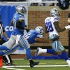 Photo - Dallas Cowboys wide receiver Dez Bryant (88) scores on a 50-yard touchdown reception as Detroit Lions outside linebacker DeAndre Levy (54) defends in the fourth quarter of an NFL football game in Detroit, Sunday, Oct. 27, 2013. (AP Photo/Rick Osentoski)