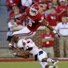 Oklahoma\'s Dominique Whaley (8) leaps over Ball State\'s Armand Dehaney (13) during the college football game between the University of Oklahoma Sooners (OU) and the Ball State Cardinals at Gaylord Family-Memorial Stadium on Saturday, Oct. 01, 2011, in Norman, Okla. Photo by Bryan Terry, The Oklahoman