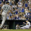 Photo - Kansas City Royals' David Lough slides home past Seattle Mariners starting pitcher Taijuan Walker to score on a single by Jarrod Dyson during the fourth inning of a baseball game Wednesday, Sept. 4, 2013, in Kansas City, Mo. (AP Photo/Charlie Riedel)