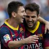 Photo - FC Barcelona's Lionel Messi, from Argentina, left, celebrates with his teammate Cesc Fabregas, after scoring a goal against Almeria during a Spanish La Liga soccer match in Almeria, Spain, Saturday, Sept. 28, 2013. (AP Photo/Daniel Tejedor)
