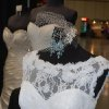 Photo - This short, cocktail-style dress by Maggie Sottero, on display from RL Bridal and Prom in Oklahoma City, is one that may appeal to brides who want a simpler, streamlined wedding. Photo by Annette Price