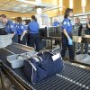 TSA agents help travelers move through a security checkpoint at Will Rogers World Airport in Oklahoma City, Friday, August 12, 2011. Photo by Bryan Terry, The Oklahoman