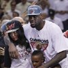 Photo -   The Miami Heat's LeBron James embraces his fiancé Savannah Brinson and his children LeBron James Jr., 7 and Bryce Maximus James 5 after Game 5 of the NBA finals basketball series against the Oklahoma City Thunder, Thursday, June 21, 2012, in Miami. The Heat won 121-106 to become the 2012 NBA Champions. (AP Photo/Lynne Sladky)