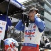 Takuma Sato, of Japan, removes his earplugs after driving during practice for the Indianapolis 500 IndyCar auto race at the Indianapolis Motor Speedway in Indianapolis, Monday, May 19, 2014. (AP Photo/Michael Conroy)