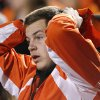 An Oklahoma State fan reacts to a Sooner touchdown in the fourth quarter during the Bedlam college football game between the University of Oklahoma Sooners (OU) and the Oklahoma State University Cowboys (OSU) at Boone Pickens Stadium in Stillwater, Okla., Saturday, Nov. 27, 2010. Photo by Chris Landsberger, The Oklahoman