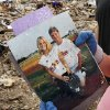 Jill Tompkins, 28, stands in the rubble of her home at 1001 SW 15, holding a picture of her with her dad, Larry Tompkins, when she was a young softball player for the Washington Wild Things. A volunteer from Moore First Baptist Church had just handed her these photos after he recovered them from the debris. Tompkins thanked him repeatedly and smiled big, explaining to him why these pictures are of such value to her. Her dad, who was her softball coach from age five through high school, died in March. She said her dad