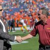 Photo - Washington Redskins Mike Shanahan, right, greets Denver Broncos executive vice president of football operations John Elway before an NFL football game, Sunday, Oct. 27, 2013, in Denver. (AP Photo/Jack Dempsey)