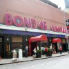 """Photo - This May 21, 2014 photo shows the exterior of Bond 45 Restaurant in New York. The cavernous Italian steakhouse has chops, pizzas and pastas and a massive antipasto bar at the entrance to the dark-stained paneled space. Some may say it is overpriced _ the meat lasagna comes with a $27 price tag _ but it remains such a go-to for well-heeled theater diners that it made a cameo in the TV series """"Smash."""" (AP Photo/Mark Kennedy)"""