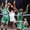 Oklahoma City's Russell Westbrook, center, takes a shot between Boston's Kendrick Perkins, left, and Kevin Garnett, second from right, as Rajon Rondo looks on in the first half Friday. Photo by Nate Billings, The Oklahoman