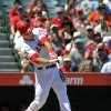 Photo -   Los Angeles Angels' Mike Trout hits a solo home run during the first inning of their baseball game against the Detroit Tigers, Sunday, Sept. 9, 2012, in Anaheim, Calif. (AP Photo/Mark J. Terrill)