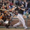 Photo - Miami Marlins' Derek Dietrich watches his two-run home run off San Francisco Giants starting pitcher Yusmeiro Petit, in front of Giants catcher Buster Posey during the third inning of a baseball game Friday, May 16, 2014, in San Francisco. (AP Photo/Eric Risberg)
