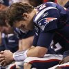 Photo - New England Patriots quarterback Tom Brady sits on the bench during the second half of the NFL Super Bowl XLVI football game against the New York Giants, Sunday, Feb. 5, 2012, in Indianapolis. (AP Photo/Paul Sancya)  ORG XMIT: SB445