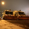 Sanitation trucks mounted with snow plows are parked on the west side of Manhattan in New York, Thursday, Jan. 2, 2014. The National Weather Service is forecasting 4 to 8 inches of snow overnight in the city. (AP Photo/Peter Morgan)