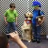 Kindergarten twin brothers Telly Keepers, left, and Tattoo Keepers, 6, pose for a photo with Jack, a therapy dog from Illinois with Therapy Dogs International, during a meet and greet with teachers and students from Plaza Towers Elementary at Eastlake Elementary School in Oklahoma City, Thursday, May 23, 2013. Seven Plaza Towers students died when a tornado destroyed the school in Moore, Okla., on Monday. Volunteers from Best Buy were taking photos of Plaza Elementary students and teachers and providing free prints. Photo by Nate Billings, The Oklahoman