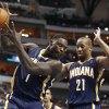 Photo - Indiana Pacers shooting guard Lance Stephenson (1) rebounds the ball in front of power forward David West (21) during the first half of an NBA game against the Dallas Mavericks, Sunday, March 9, 2014, in Dallas, Texas. (AP Photo/Jim Cowsert)