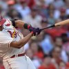 Photo - St. Louis Cardinals' Jhonny Peralta follows through on an RBI double against the San Diego Padres in the second inning in a baseball game, Saturday, Aug. 16, 2014, at Busch Stadium in St. Louis. (AP Photo/Bill Boyce)