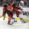 New York Rangers\' Carl Hagelin, of Sweden, tries to control the puck as New Jersey Devils\' Jacob Josefson (16), of Sweden, and Marek Zidlicky, of the Czech Republic, try to make a steal during the first period of an NHL hockey game game Saturday, March 22, 2014, in Newark, N.J. (AP Photo/Mel Evans)