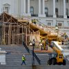 Photo - FILE - This Nov. 28, 2012 file photo shows construction contining on Capitol Hill in Washington, on the viewing stand for President Barack Obama's January's Inauguration Day ceremonies.  Four years ago, Barack Obama's swearing-in drew a jubilant record crowd to the National Mall to witness history: the country's first black president taking the oath of office. This time, the capital is pre-occupied with a looming economic crisis, exit from war and reshuffling in Congress. It's almost as if Obama's swearing in on the Martin Luther King Jr. holiday is a been-there-done-that moment.  (AP Photo/J. Scott Applewhite, File)