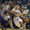 Orlando Magic guard J.J. Redick, right, drives around Phoenix Suns center Jermaine O\'Neal during the first half of an NBA basketball game in Orlando, Fla., on Sunday, Nov. 4, 2012. (AP Photo/Reinhold Matay)