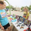 Kara Drewke, 17, and her sister Erin, 13, set up their booth of handmade items at the Edmond Youth Market during the Wednesday Farmer\'s Market, Wednesday, June 1, 2011. The Drewke\'s are starting a business called 2 Busy Chicks Designs. Photo by David McDaniel, The Oklahoman