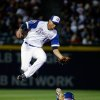 Photo - Atlanta Braves shortstop Andrelton Simmons, left, jumps over New York Mets' Curtis Granderson as he steals second base in the sixth inning of baseball game, Tuesday, April 8, 2014, in Atlanta. (AP Photo/David Goldman)