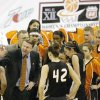 OSU head coach Kurt Budke talks to his team during a timeout in the first half during the Oklahoma State University (OSU) vs Texas Tech University women\'s college basketball game at the women\'s Big 12 conference tournament at Reunion Arena in Dallas, Texas, Tuesday, March 7, 2006. By Matt Strasen, The Oklahoman