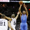 Oklahoma City\'s Russell Westbrook (0) shoots over San Antonio\'s Tony Parker (9) as Tim Duncan (21) looks on during Game 5 of the Western Conference Finals between the Oklahoma City Thunder and the San Antonio Spurs in the NBA basketball playoffs at the AT&T Center in San Antonio, Monday, June 4, 2012. Photo by Nate Billings, The Oklahoman