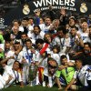 Real Madrid team pose with theChampion League trophy, after winning the Champion League title, against Atletico Madrid 4-1, in Lisbon, Portugal, Saturday, May 24, 2014. (AP Photo/Daniel Ochoa de Olza)