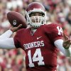 FILE - In this Oct. 29, 2009, file photo, Oklahoma quarteback Sam Bradford throws during an NCAA college football game against Baylor in Norman, Okla. Bradford is a top prospect in the NFL draft. (AP Photo/Sue Ogrocki, File) ORG XMIT: ny203