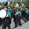 Photo - Norman North High School's marching band performs with the Norman High School marching band at a Veterans Day parade. OKLAHOMAN ARCHIVES  PAUL B. SOUTHERLAND