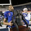 Tulsa quarterback Cody Green carries the Liberty Bowl trophy after his team beat Iowa State in the NCAA college football game in Memphis, Tenn., Monday, Dec. 31, 2012. Tulsa won 31-17. (AP Photo/Rogelio V. Solis)