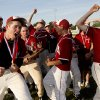 Tuttle\'s Garrett Bayliff, left, celebrates after Tuttle\'s win in the Class 4A high school baseball championship game between Tuttle and Weatherford in Shawnee, Okla., Saturday, May 16, 2009. Photo by Bryan Terry, The Oklahoman