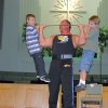 Team Impact member Greg Markum (Edmond resident and former Mr. Oklahoma) presses Wyatt Winter( left), and Bryson Smith (right). Tracy Markum, along with Greg Lewis, were at Edmond\'s First Baptist Church to prepare for their 5-day event, October 25-29 Community Photo By: Brad Kimbler Submitted By: Brad, Edmond