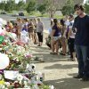 Actor Christian Bale and his wife Sibi Blazic visit a memorial to the victims of Friday\'s mass shooting, Tuesday, July 24, 2012, in Aurora, Colo. Twelve people were killed when a gunman opened fire during a late-night showing of the movie