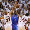 Oklahoma City\'s Kendrick Perkins (5) grabs the ball between Miami\'s Shane Battier (31) and James Jones (22) during Game 3 of the NBA Finals between the Oklahoma City Thunder and the Miami Heat at American Airlines Arena, Sunday, June 17, 2012. Photo by Bryan Terry, The Oklahoman