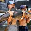 Corbin Good, left, and Ian Good hold Corbin\'s 37.9 catfish during the weigh-ins at the 14th annual Okie Noodling Tournament at Wacker Park in Pauls Valley, Okla., Saturday, June 22, 2013. Photo by Sarah Phipps, The Oklahoman
