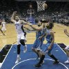 Orlando Magic\'s Josh McRoberts (17) passes the ball behind his head to Nikola Vucevic, right, of Montenegro, as he is defended by New Orleans Hornets\' Ryan Anderson (33), Dominic McGuire (5) and Robin Lopez (15) during the first half of an NBA basketball game on Wednesday, Dec. 26, 2012, in Orlando, Fla. (AP Photo/John Raoux)