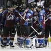Colorado Avalanche left wing Patrick Bordeleau, front left, congratulates teammate Aaron Palushaj as they join teammates to celebrate the Avalanche\'s 6-2 victory over the Chicago Blackhawks in an NHL hockey game in Denver on Friday, March 8, 2013. Chicago\'s loss was its first in regulation this season. (AP Photo/David Zalubowski)