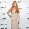 FILE - In this Feb. 6, 2013 file photo, actress Lindsay Lohan attends amfAR\'s New York gala at Cipriani Wall Street in New York. Lohan is due back in court on Monday March 18, 2013 for a hearing that will lay out when her trial will begin on misdemeanor charges she lied to police and was driving recklessly when her sports car crashed in June 2012. Lohan\'s trial is scheduled to begin this week, but her attorney has previously sought a delay. (Photo by Evan Agostini/Invision/AP, File)