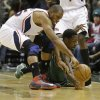 Atlanta Hawks\' Al Horford, left, and Milwaukee Bucks\' Larry Sanders, right, dive for the loose ball during the second half of an NBA basketball game, Saturday, Feb. 23, 2013, in Milwaukee. (AP Photo/Jeffrey Phelps)