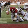 OU\'s Blake Bell (10) scores a touchdown beside UT\'s Mykkele Thompson (2), Demarco Cobbs (7), and Steve Edmond (33) during the Red River Rivalry college football game between the University of Oklahoma (OU) and the University of Texas (UT) at the Cotton Bowl in Dallas, Saturday, Oct. 13, 2012. Photo by Bryan Terry, The Oklahoman