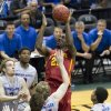 Photo - Iowa State forward Dustin Hogue (22) takes a shot over Boise State defenders during the first half of an NCAA college basketball game at the Diamond Head Classic on Wednesday, Dec. 25, 2013, in Honolulu. (AP Photo/Eugene Tanner)