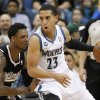 Photo - Minnesota Timberwolves guard Kevin Martin (23) drives to the basket against Sacramento Kings guard Ben McLemore, left, during the first quarter of an NBA basketball game in Minneapolis, Sunday, March 16, 2014. (AP Photo/Ann Heisenfelt)