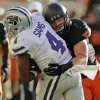 Oklahoma State\'s Caleb Lavey (45) tackles Kansas State\'s Daniel Sams (4) during a college football game between the Oklahoma State University Cowboys (OSU) and the Kansas State University Wildcats (KSU) at Boone Pickens Stadium in Stillwater, Okla., Saturday, Oct. 5, 2013. OSU won, 33-29. Photo by Nate Billings, The Oklahoman