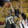 Midwest City\'s Richa Jackson (15) looks to pass away from Kim Hayes (13) of Norman during the Class 6A girls high school basketball state tournament final between Midwest City and Norman at the ORU Mabee Center in Tulsa, Okla., Saturday, March 13, 2010. Photo by Nate Billings, The Oklahoman